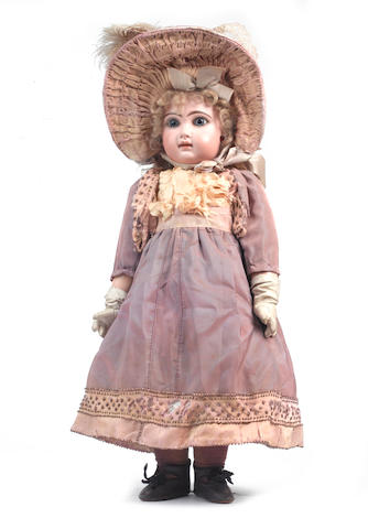 A fine size 9 closed mouth Tete Jumeau bisque head Bebe, French circa 1890 54cm (21in) tall.