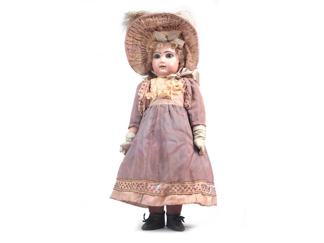 A fine size 9 closed mouth Tete Jumeau bisque head Bebe, French circa 1890