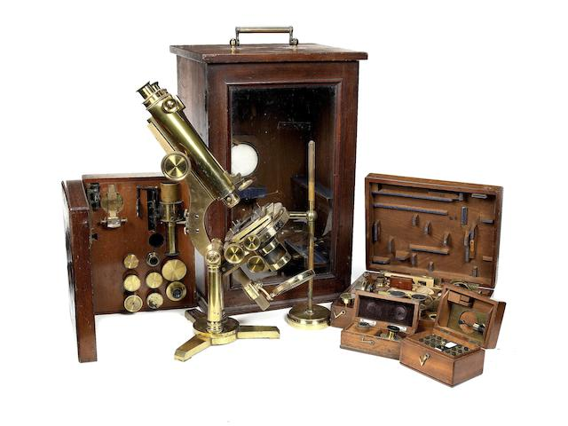 An R & J Beck brass binocular compound microscope,  English,  circa 1870,