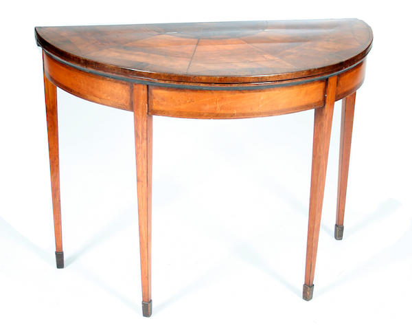 A late George III mahogany and satinwood demi-lune fold-over card table