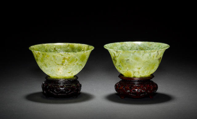 A pair of translucent jade or hardstone bowls