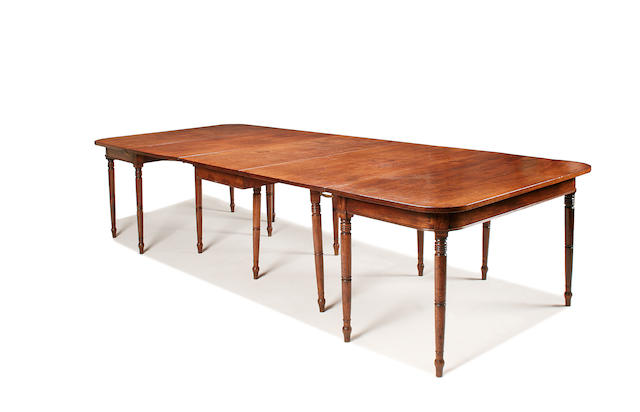 A late George III mahogany extending dining table