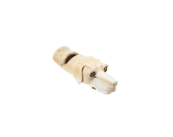 An ivory dog's head whistle