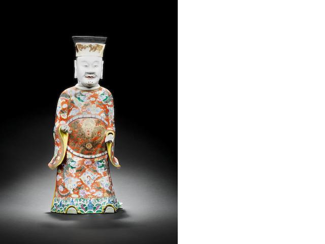 A large famille rose standing dignitary Late Qianlong/Jiaqing