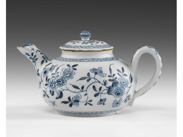 An English delftware teapot and cover (part of the spout very cleanly restuck)