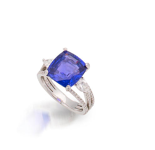 A very fine colour-change sapphire and diamond ring