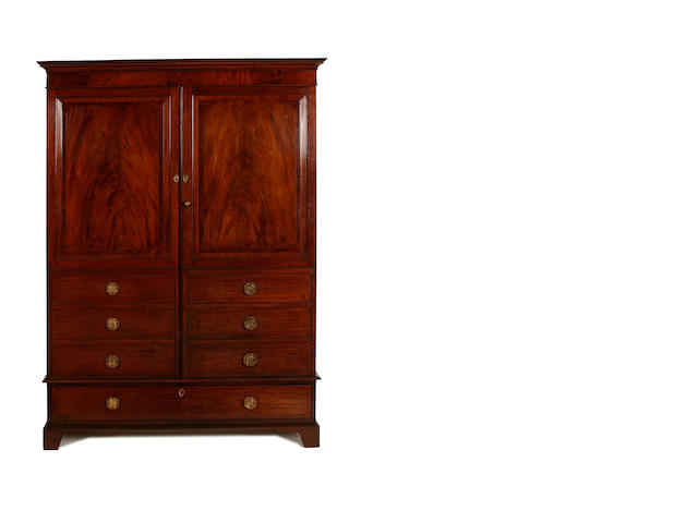 An early 19th century mahogany wardrobe