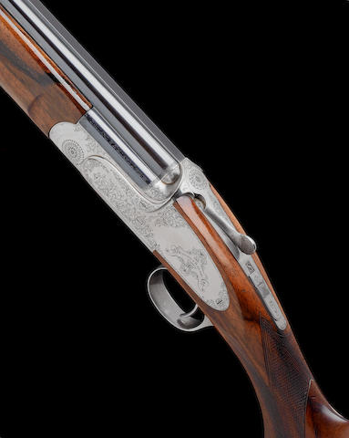A fine 20-bore (2¾in) 'The Sporting Model' single-trigger over-and-under ejector gun by Holland & Holland, no. 50557 In its leather case with makers accessories including multi-choke set comprising skeet, cylinder, 3/8 & 5/8 chokes, together with their choke-key