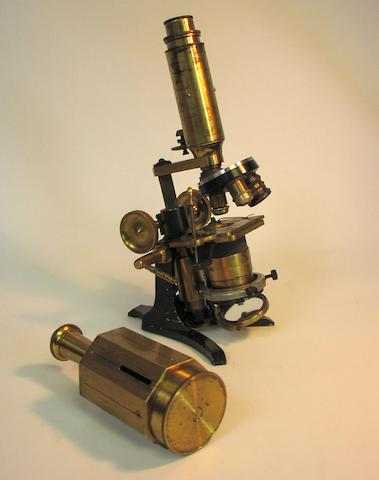 A brass compound monocular microscope and a surveyor's cross staff,