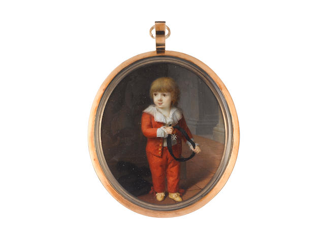 French School, circa 1775 A Noblechild, wearing red suit with ribbon bows at the ankles, gold buttons and white cuffs, white chemise with frilled lace collar and cuffs, cream shoes with ribbon bows, he holds the Order of St John of Jerulsalem on a black ribbon and stands before a marble relief, a black plumed hat sits on the floor at his right heel