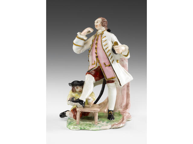 An exceptional Bow group of a gentleman and a shoe-shine boy, circa 1752-3
