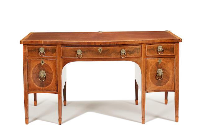 A George III mahogany and inlaid serpentine sideboard