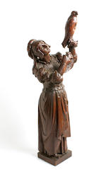 A 19th century carved oak figure of a female falconer