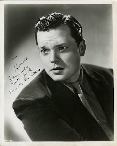 Orson Welles: An autographed black and white publicity still,