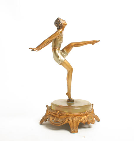 An Austrian Art Deco cold painted spelter figure of a female athlete