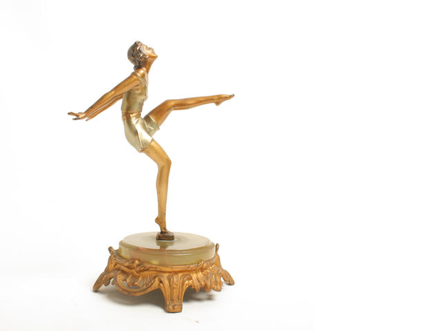 An Art Deco female figure on associated onyx base