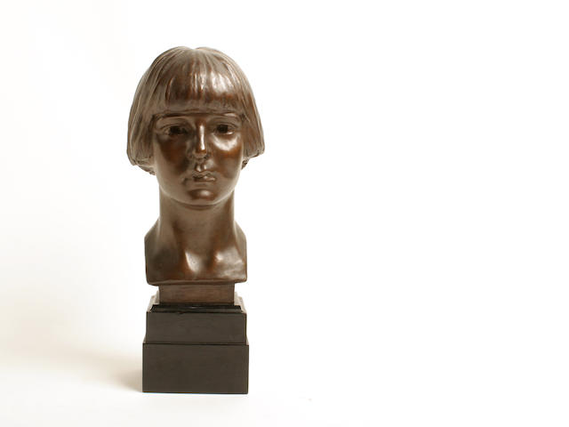 A 20th century bronze bust of a young girl