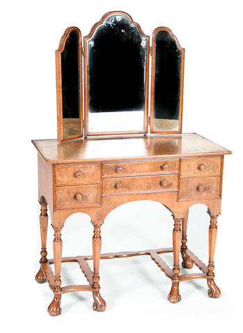 A Queen Anne-style figured walnut dressing table