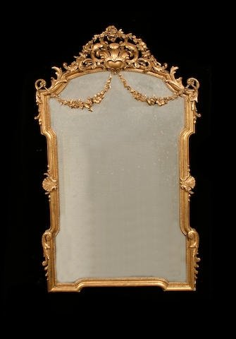 A French late 19th century giltwood and composition pier mirror