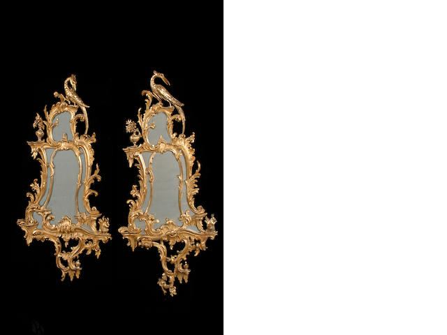 A near pair of George II style carved giltwood mirrors