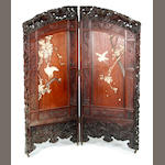A Chinese carved hardwood and bone-decorated two-fold dressing screen, circa 1900