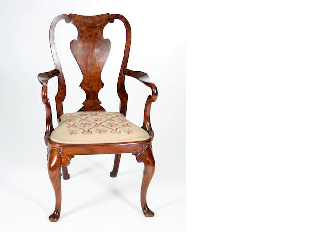 A walnut open armchair, early 20th Century, in George I-style Bearing metal label reading 'John Tucker & Son., 27 - 33 Earl's Court Rd, Kensington W3'