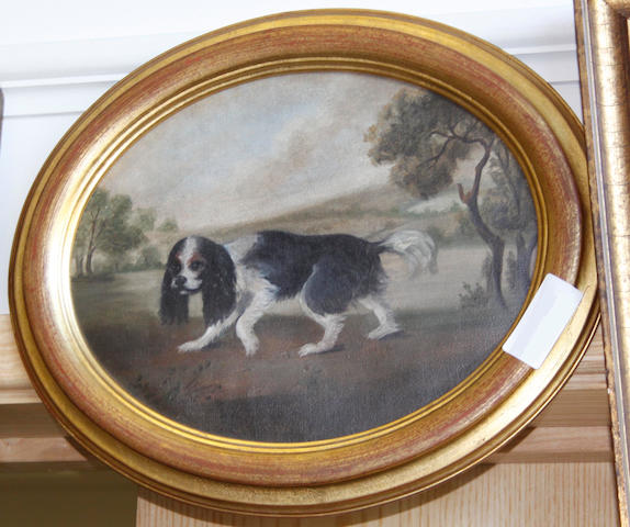 English School 20th century King Charles spaniel in a landscape