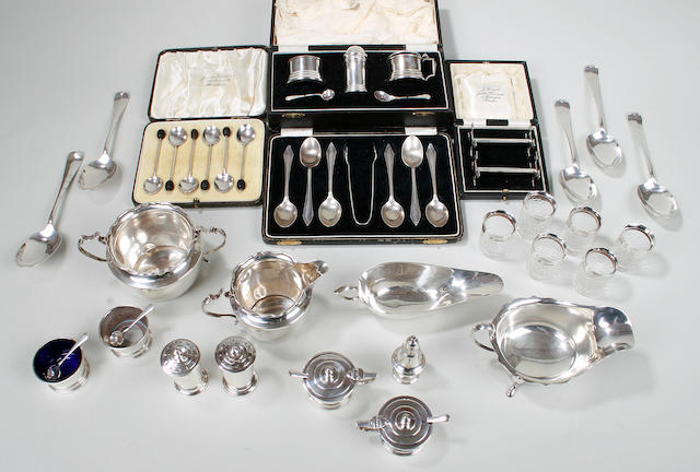 An assortment of silver flatwares, condiment sets and other silver various dates and makers 19th & 20th Century
