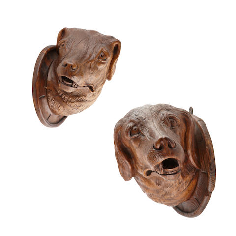 A pair of carved wooden Black Forest style Hunting dogs heads