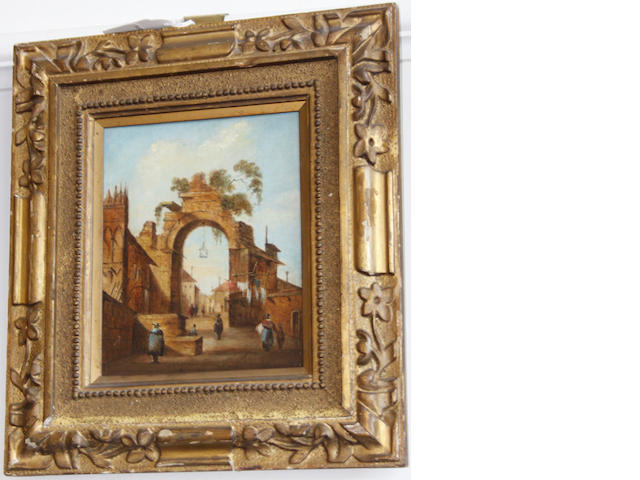 Manner of Francesco Guardi A town gate archway