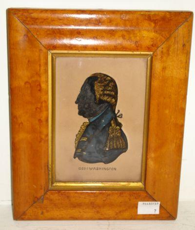A 19th Century reverse painted glass silhouette, with gilt heightend detail of George Washington in a moulded maple veneered frame,13 x 9cm.