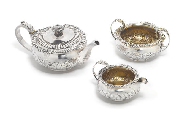 A matched George III / Edwardian silver three-piece tea service, teapot and cream jug by Wellby & Wellby, London 1909, sugar bowl by J. E. Terrey, London 1815,  (3)