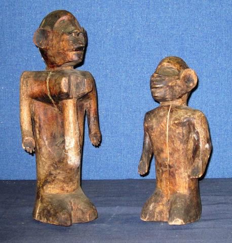 A rare pair of East African figures probably Sukuma or Kerewe