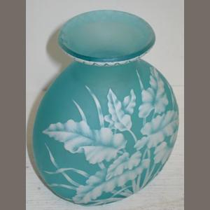 A 19th Century Cameo glass vase, of flattened form, the front decorated with leaves and grass on a pale turquoise satin ground, 12.5cm.