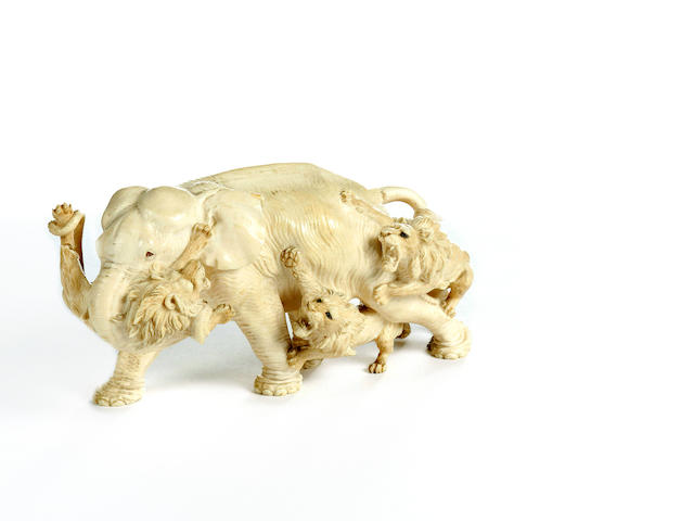 A Japanese carved ivory figure group