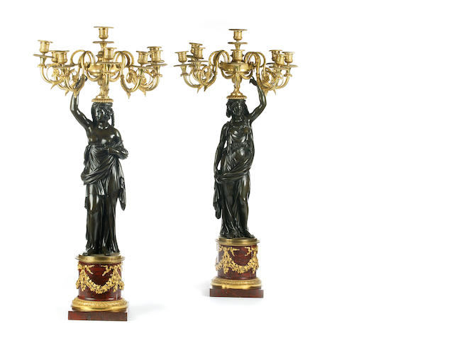 A fine pair of Louis XVI ormulu, bronze and marble eight light candelabra
