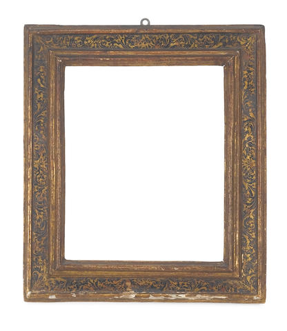 A Spanish 17th Century carved, ebonised and parcel gilt cassetta frame