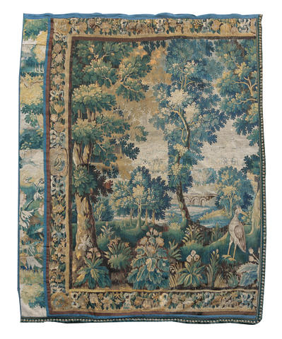 A Flemish 18th century Verdure tapestrycut in two, to form a pair