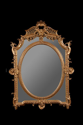 A French late 19th century giltwood and composition mirror