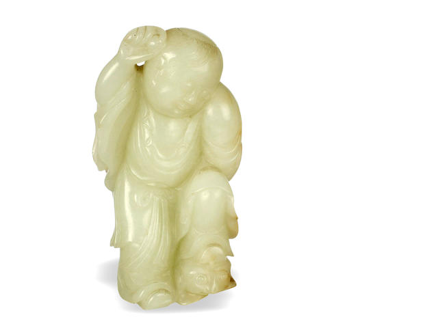 "A Chinese pale celadon figure group of a ""Boy and Frog"""