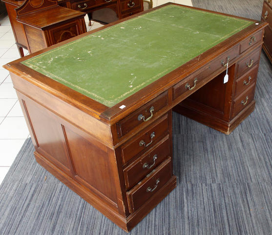An early 20th Century mahogany kneehole desk, the moulded rectangular inset top above three frieze and five pedestal drawers, on plinth bases, 152 x 92cm.