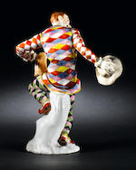 A Meissen figure of the dancing Harlequin with jug (repaired