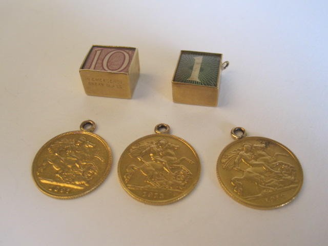 Three half sovereign coins plus two charms