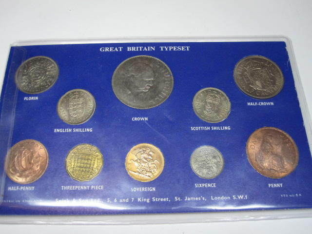 Cased set of coins, includes sovereign