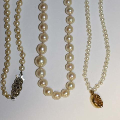 A string of slight graduated cultured pearls, to a paste set cluster clasp, another shorter string with marcasite set clasp and a double row pearl bracelet (untested) to a filigree panel clasp. (3)