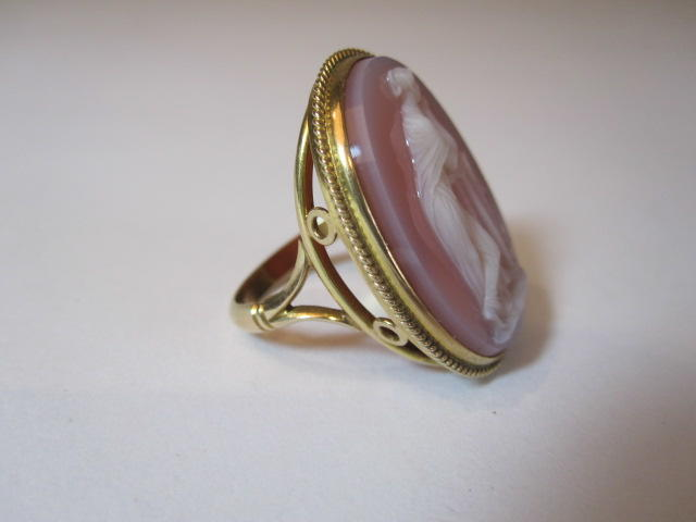 A 20thc shell cameo dress ring decorated with a classical maiden