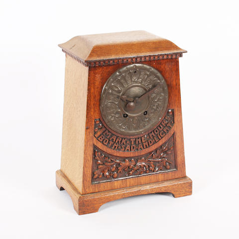 An Arts and Crafts style oak cased mantel clock
