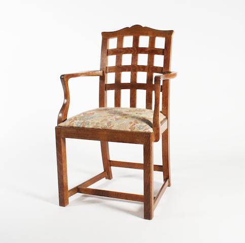 An oak elbow chair attributed to Heal's, probably designed by Ambrose Heal and influenced by Ernest Gimson