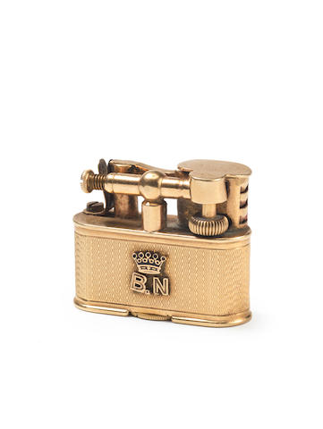 DUNHILL: A 9 carat gold 'Bijou Sports' lighter, by Alfred Dunhill, London 1929,