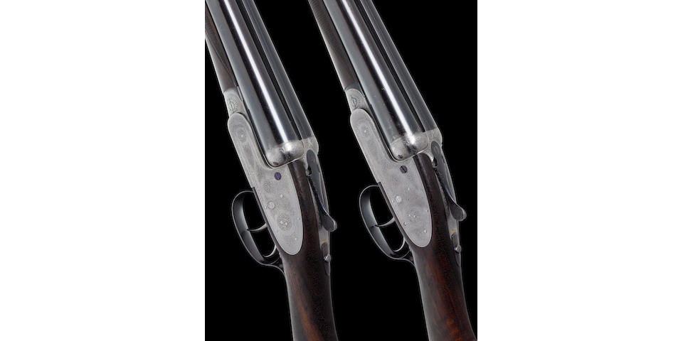 A pair of 12-bore self-opening sidelock ejector guns by J. Purdey & Sons, no. 26141/2 Built for Colonel W. Stirling In their J. Purdey & Sons leather motor-case